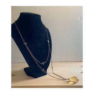 Faux gold pendant necklace with an antique finish